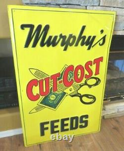 Murphy's CUT-COST FEEDS embossed tin metal VINTAGE farm SIGN dollar bill cow pig