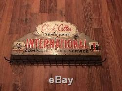 Vintage International Harvest Check Cables Tin Sign With Hooks 12 x 22