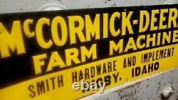 Vintage McCormick-Deering Farm Machines - Rigby Idaho - Rare embossed tin sign