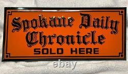 Vintage SPOKANE DAILY CHRONICLE SOLD HERE Embossed Tin sign