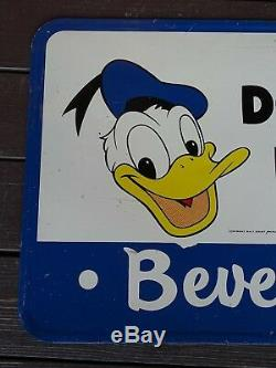 Vintage tin soda sign Donald Duck beverages extremely rare